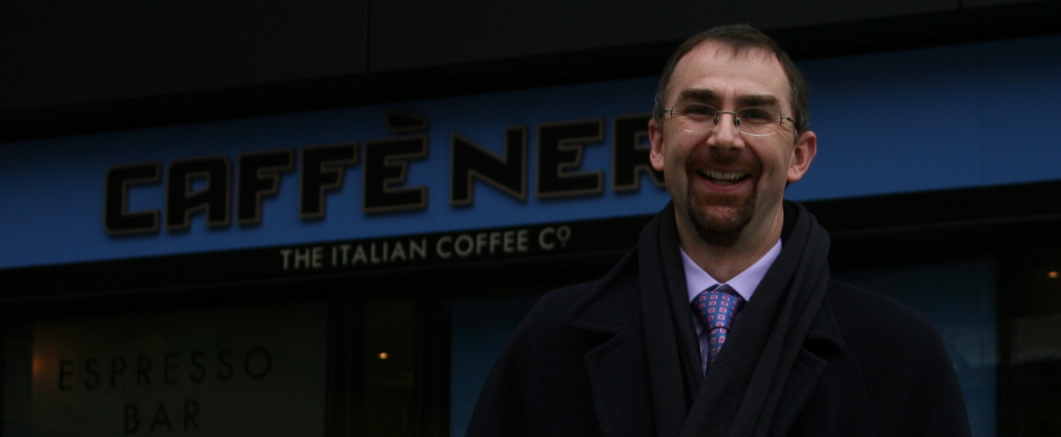Kevin outside Cafe Nero